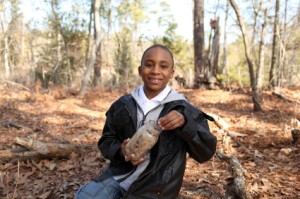 Boy in woods with jar.iStock_000019353575XSmall